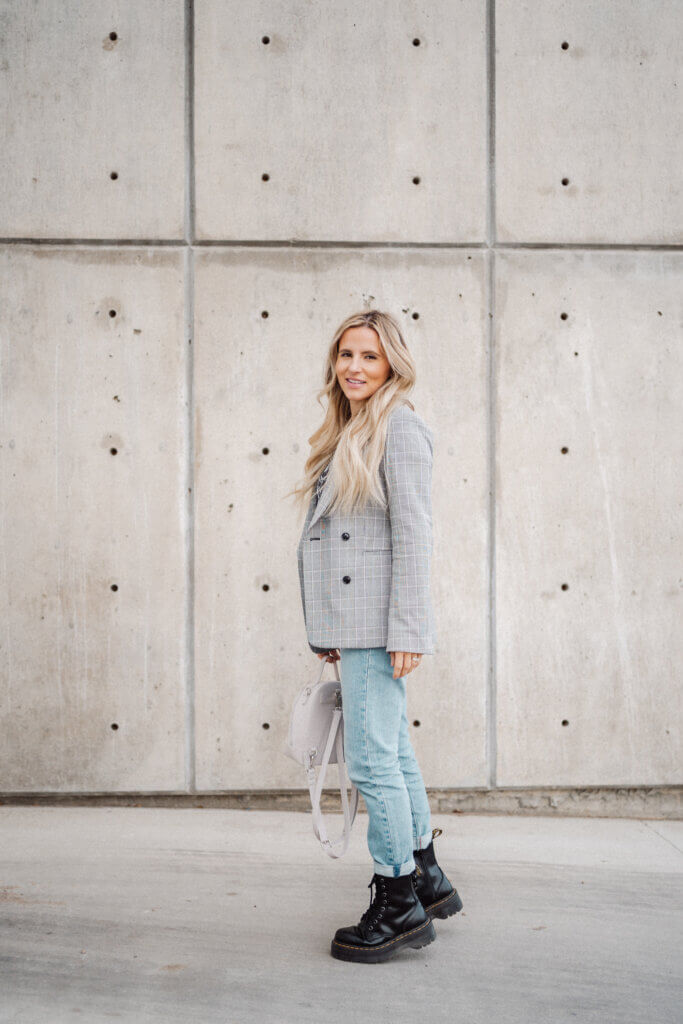 Influencer Kelsi Kendel likes her plaid blazer for fall outfits