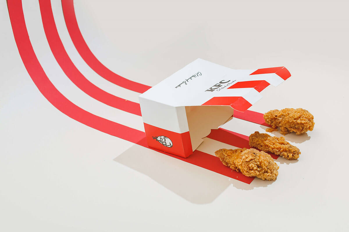 A KFC box with 3 pieces of 3-D created chicken nuggets, part of the Toast food trend forecasts for 2021