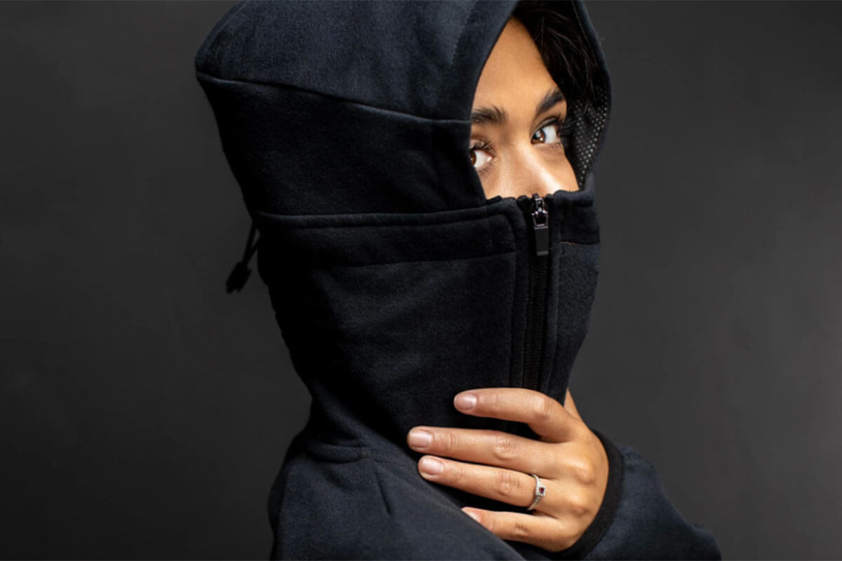 Toast Fashion Trend Forecasts for 2021 include the Bio Hoodie from G95, and this shows a hood with the  built-in mask zipped up over the girl's nose.