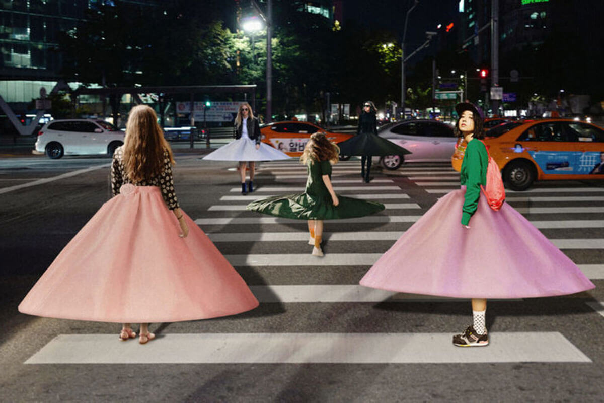 Toast fashion trend forecast with social distancing skirts worn by three girls on a street