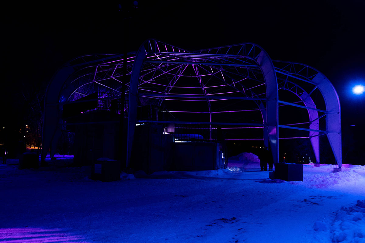 A night shot with blue and purple lights at Winter City Snow Glow, Shakespeare on the Saskatchewan in Saskatoon