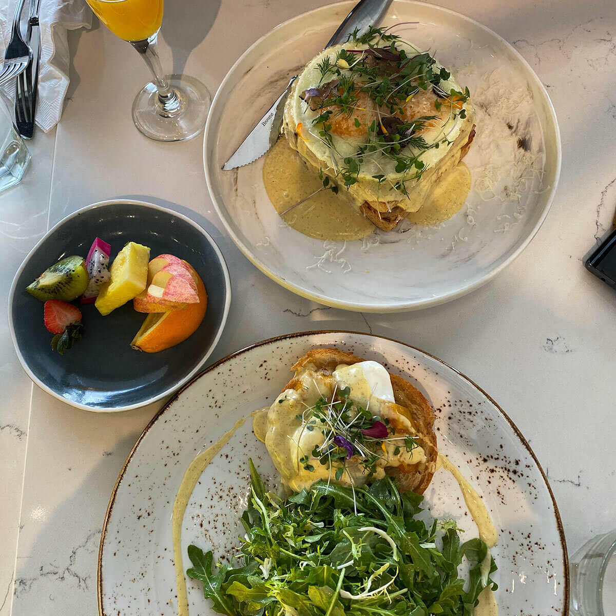 The Saskatoon January City Cuide recommends the Squash and Truffle Eggs Benedict plus fresh fruit at OEB