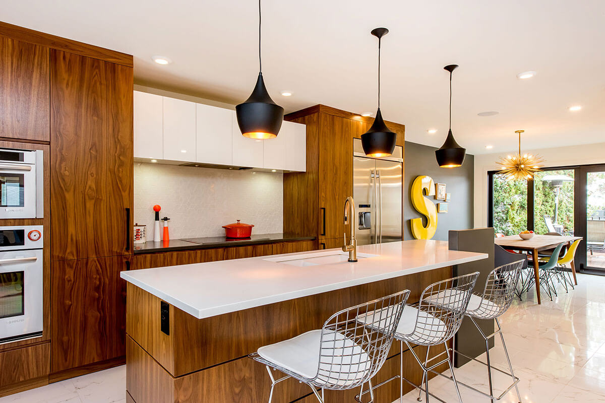 A kitchen with bronze-brown cupboards, white countertop and white floors, part of the 2021 home renovation trends