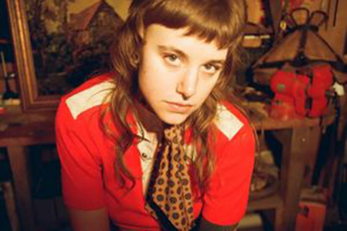 Wearing a red shirt, Cat Clyde is one of our 5 up-and-coming Canadian musicians