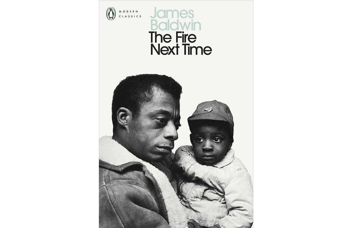 Black man and young boy on a book cover for The Fire Next Time by James Baldwin, essential non-fiction for Black History Month