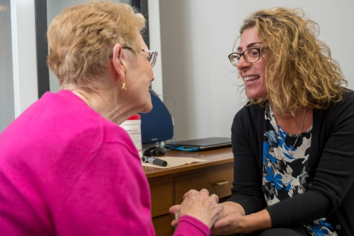 a hearing loss expert talking with a patient