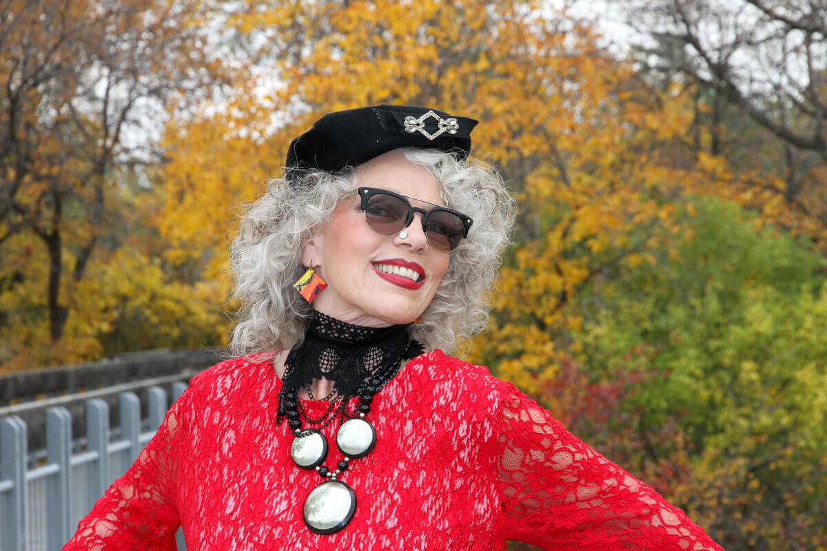 Woman modelling in red jacket and black beret, living out loud at any age