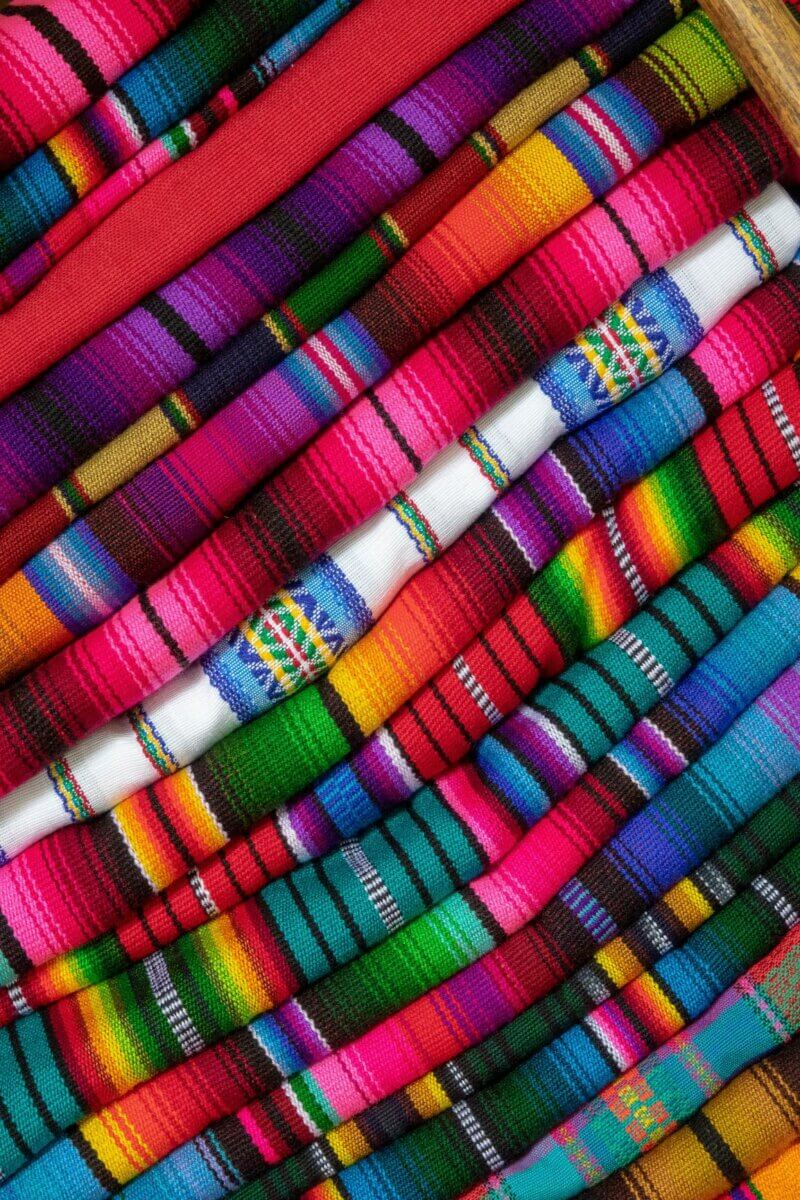 Multi-coloured Mexican blankets can be found in Cancun adventures