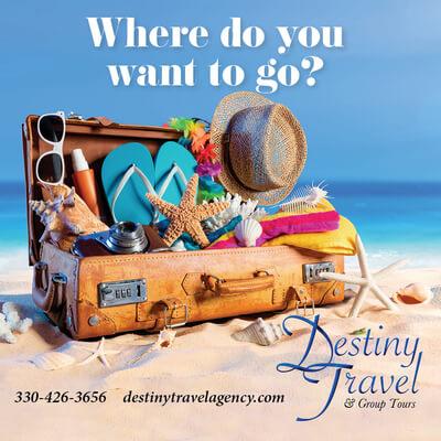 suitcase with sun gear on a beach