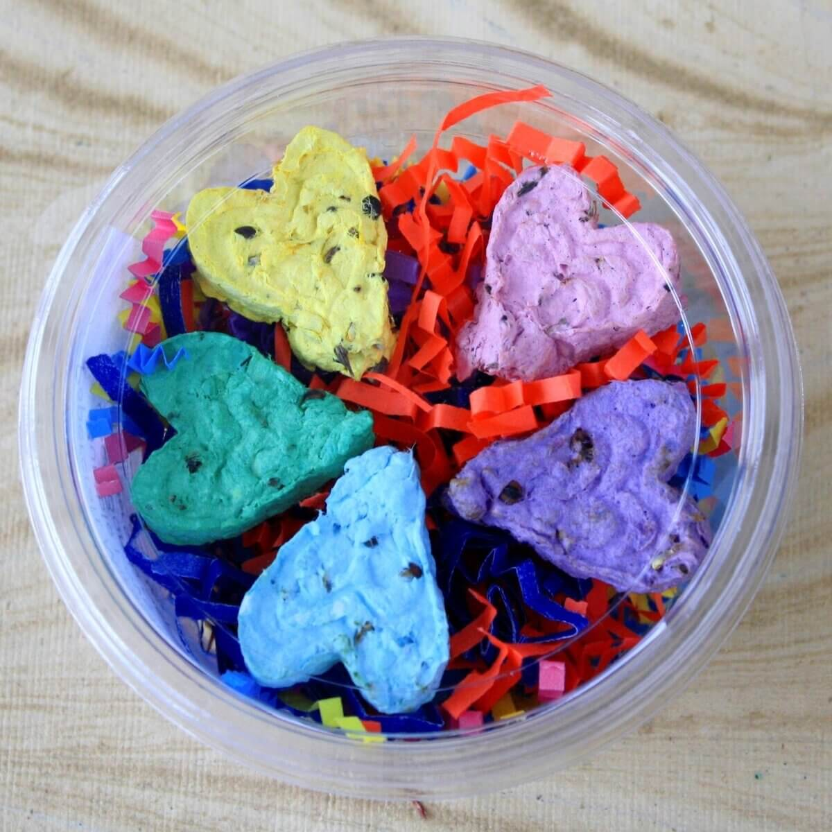 A multi-coloured bowl of seed bombs for planting wildflowers
