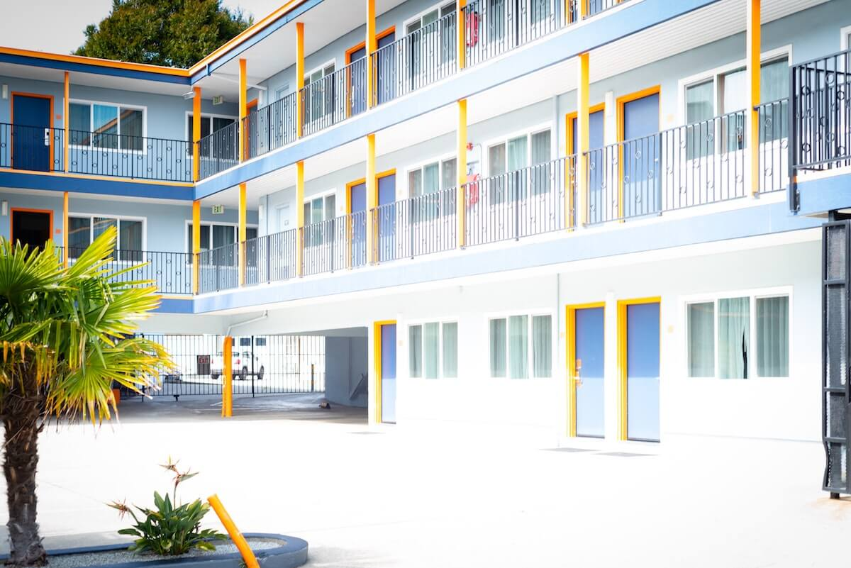 a tropical blue, white and yellow hotel