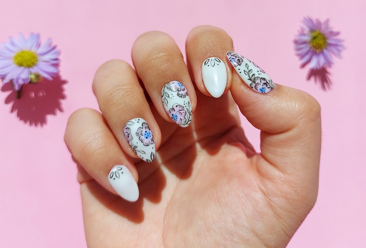 multicoloured press-on nails on a right hand
