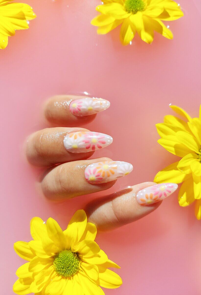 Long white press-on nails with orange and pink flowers