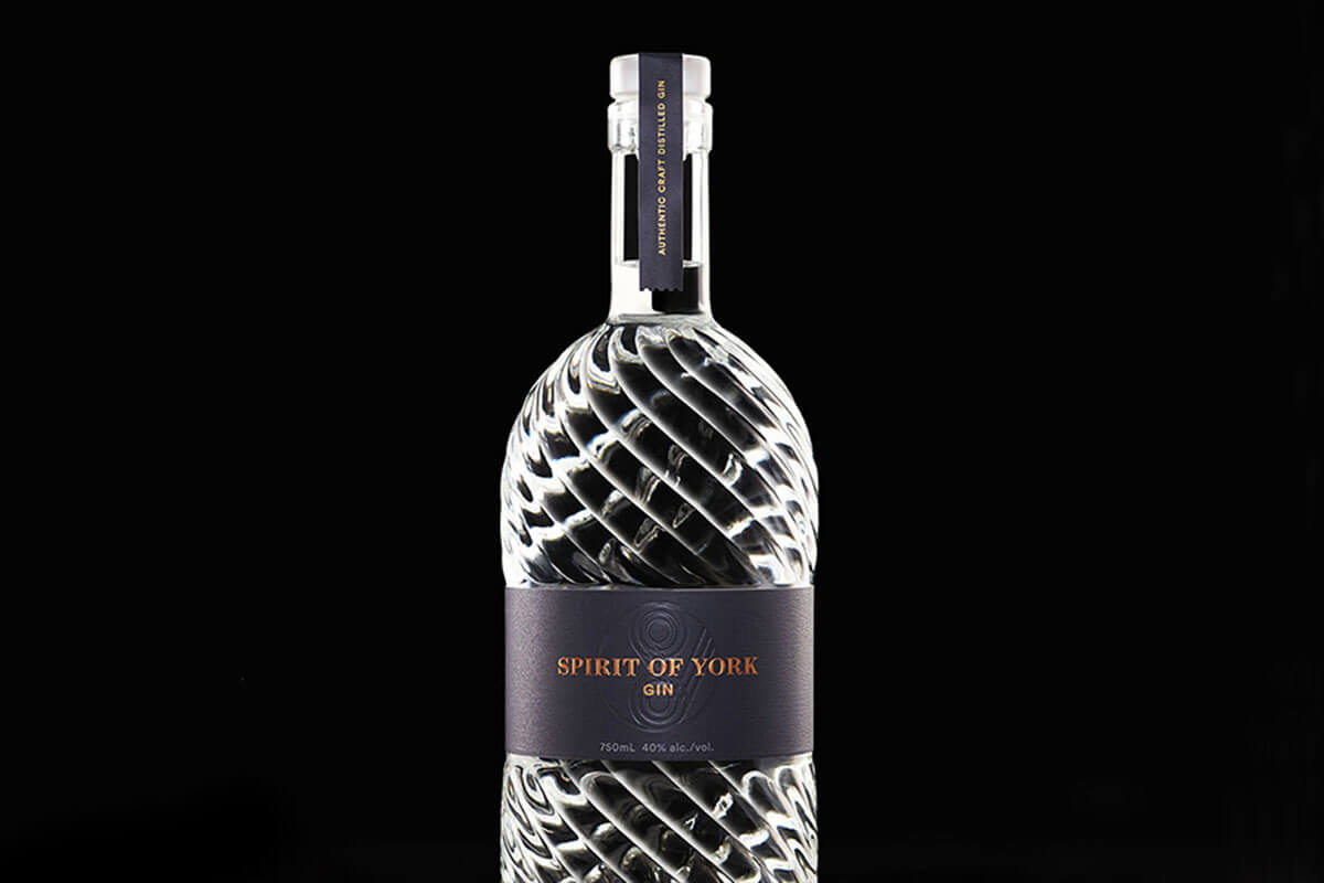 a bottle of Spirit of York on a black background, one of four Toronto craft gins