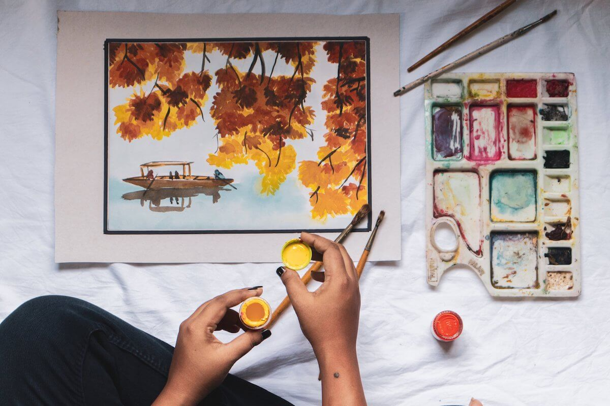 an artist painting a picture of yellow and orange flowers, Canadian art institutions