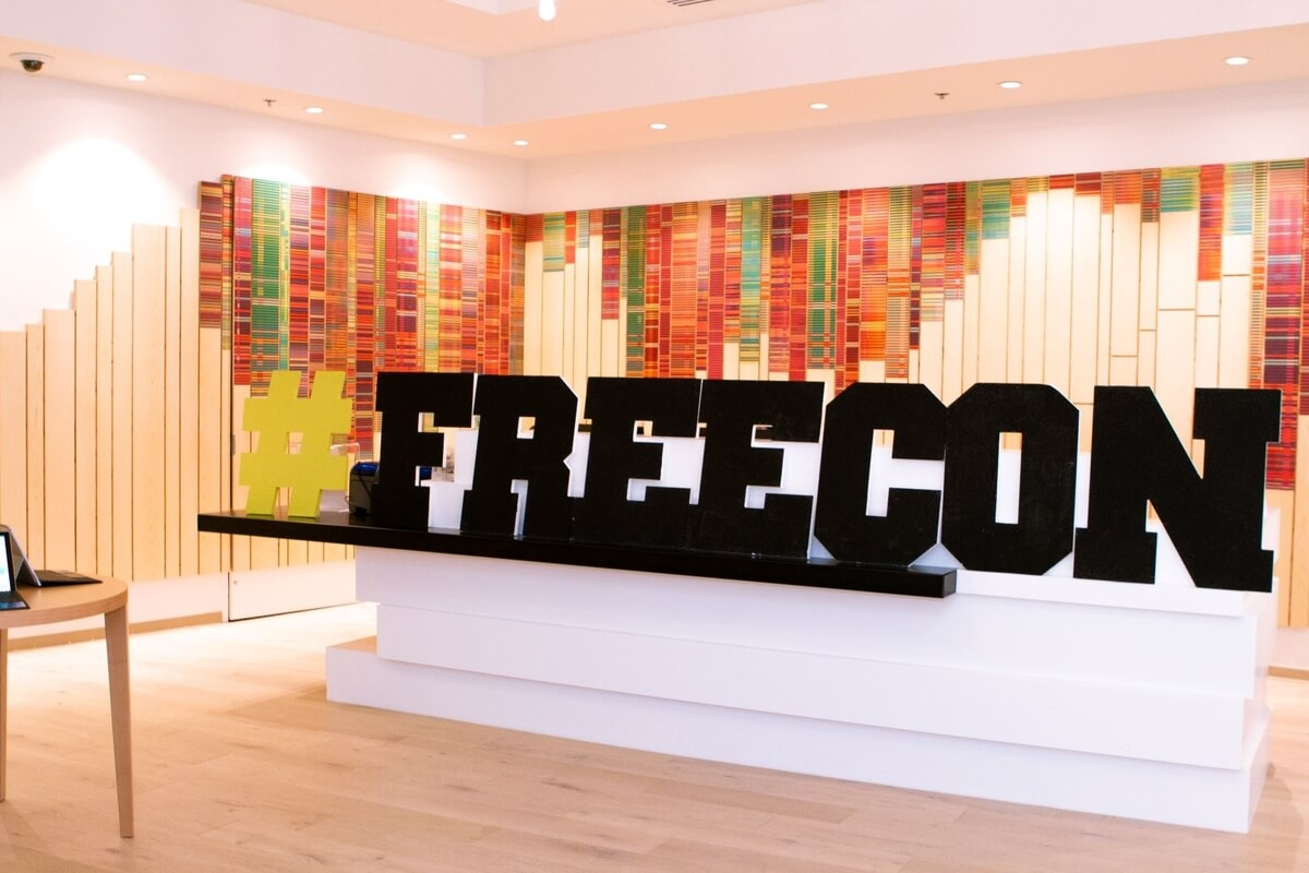 blak freecon sign with colourful background