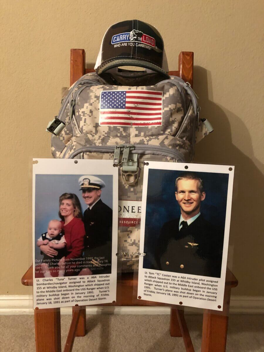 a memorial display of photos and a pack for a US fallen officer at a carry the load event in dallas