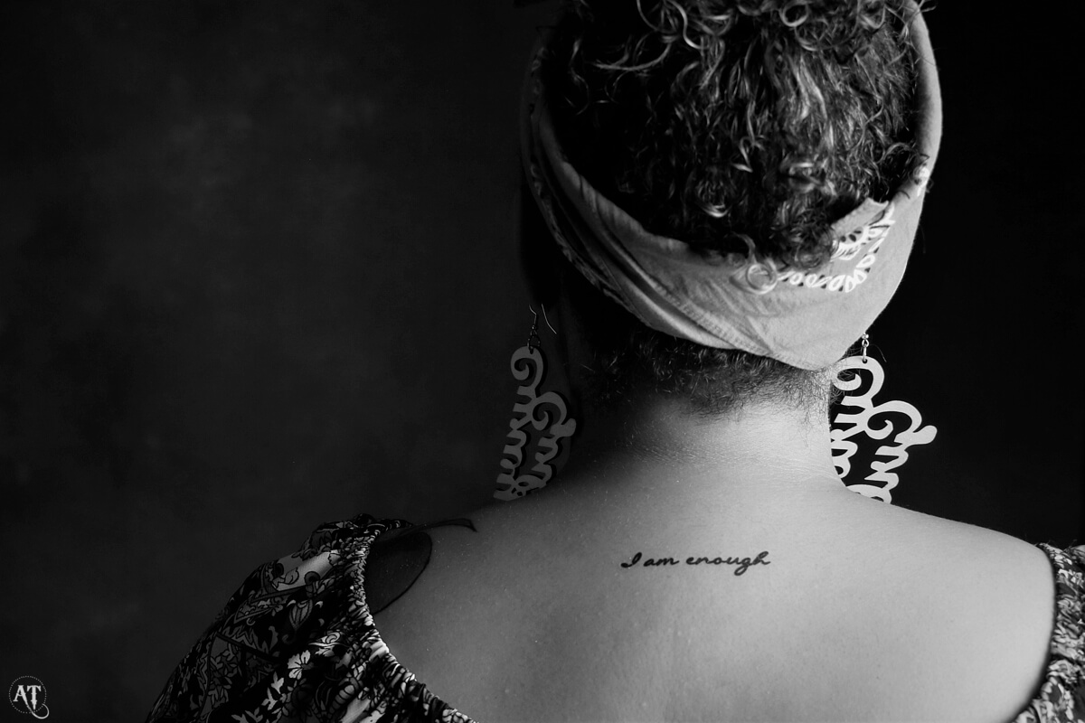 back of woman's neck with tattoo from Conscious Ink