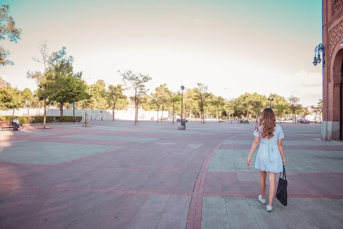 woman on a hot girl walk in summer in an urban setting