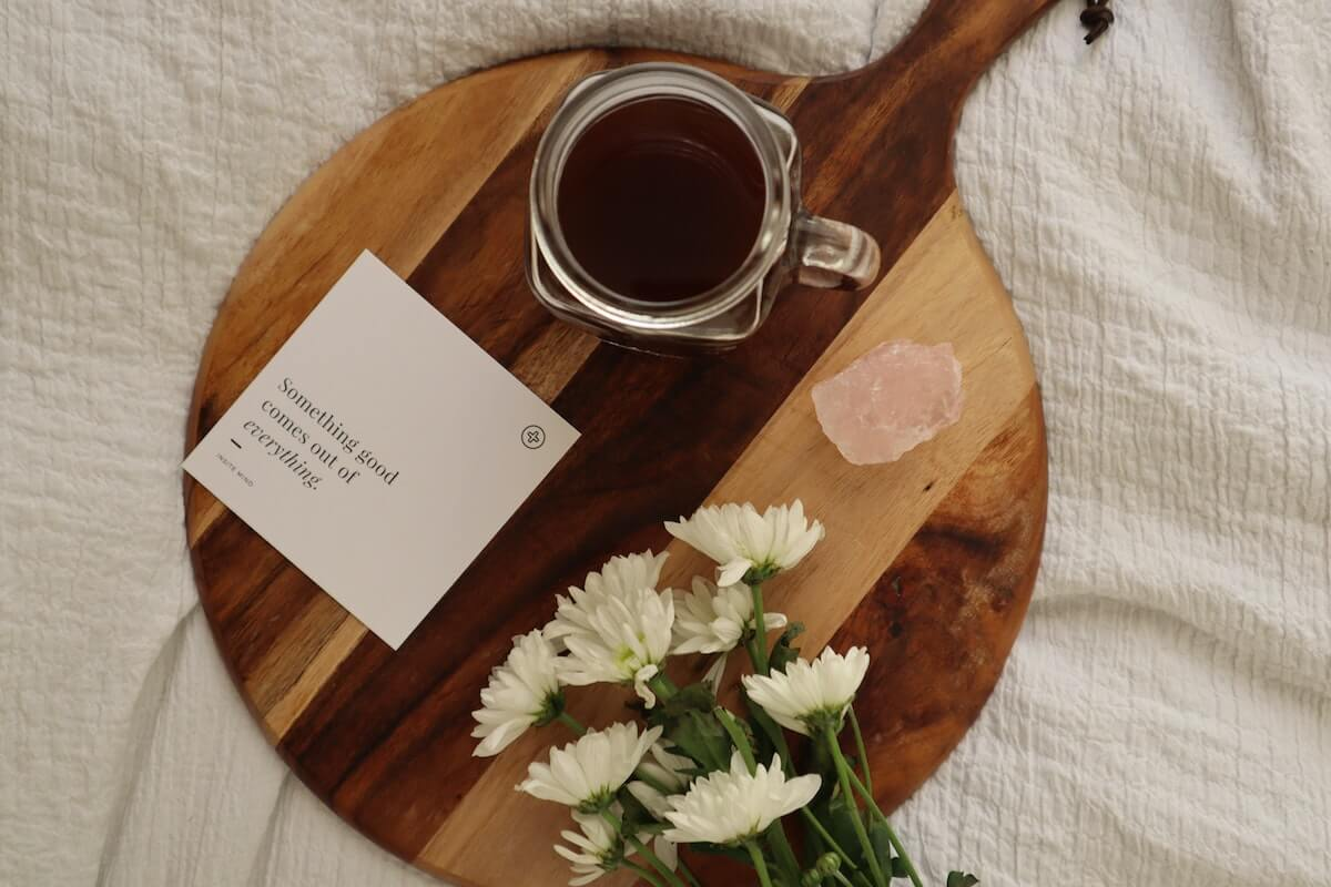 an affirmation, flowers and salt on a wooden board, one of 4 simple ways to get a better sleep