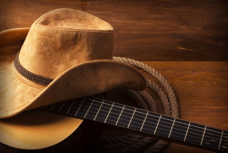 cowboy hat, guitar and rope, john michael montgomery in austin