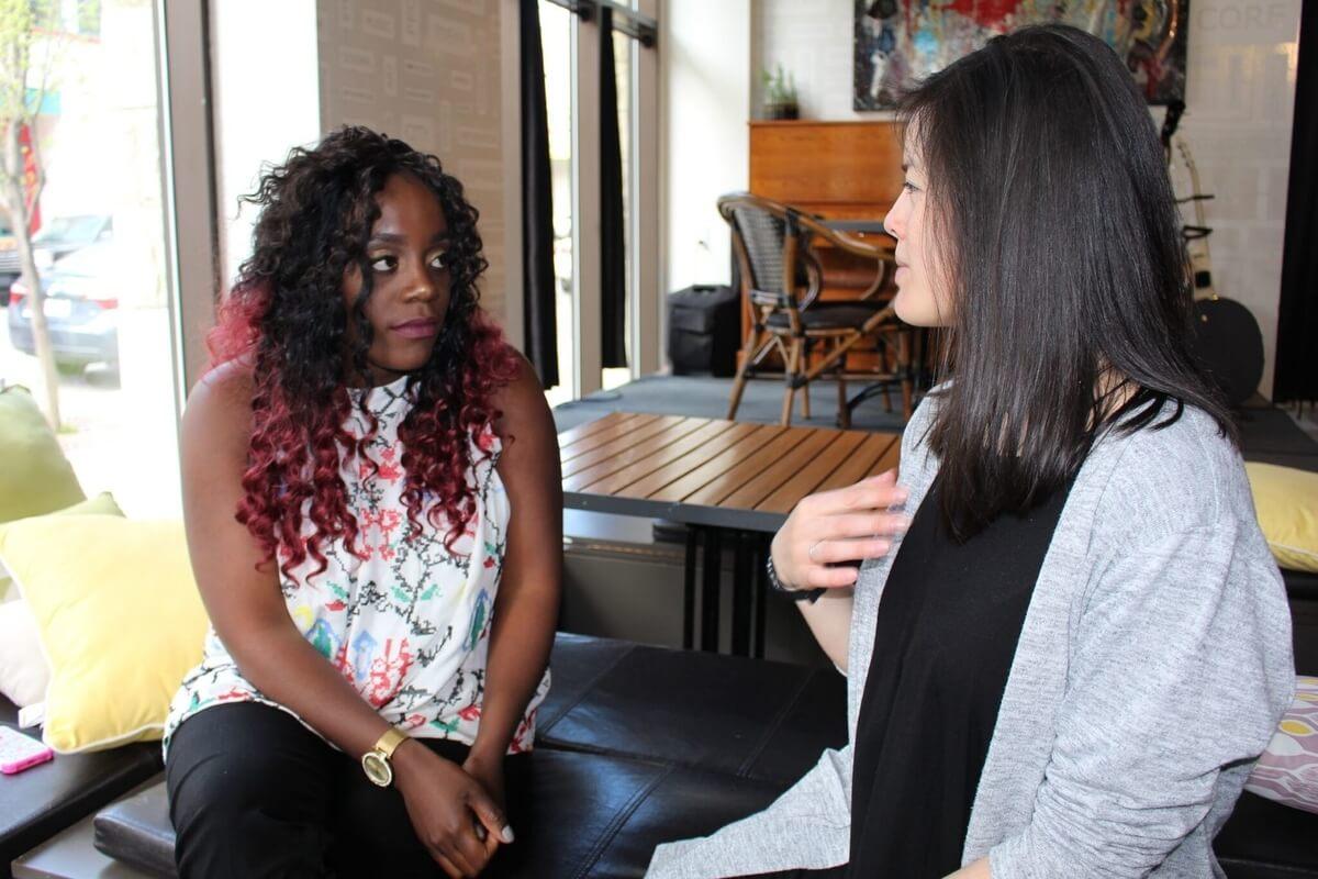2 women talking, lady viak african mentorship initiative