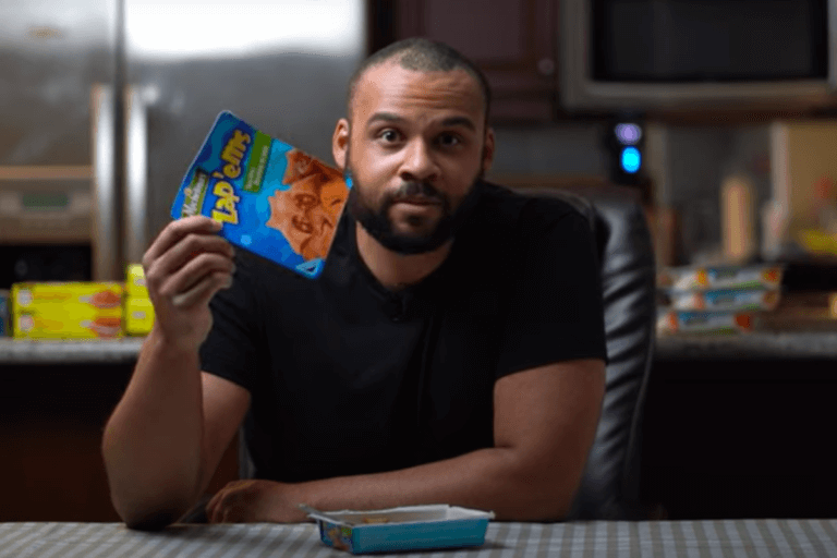 Minute Munch creator, Richard Mckoy at a kitchen table