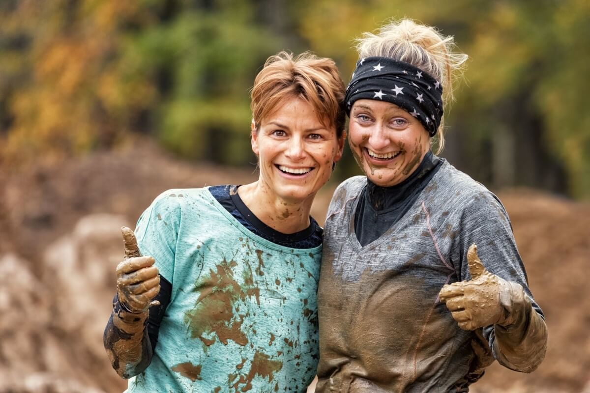 two women after a mud run, muddy milar family adventure