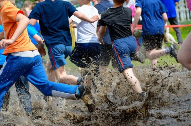 people in a mud run, muddy milar family adventure