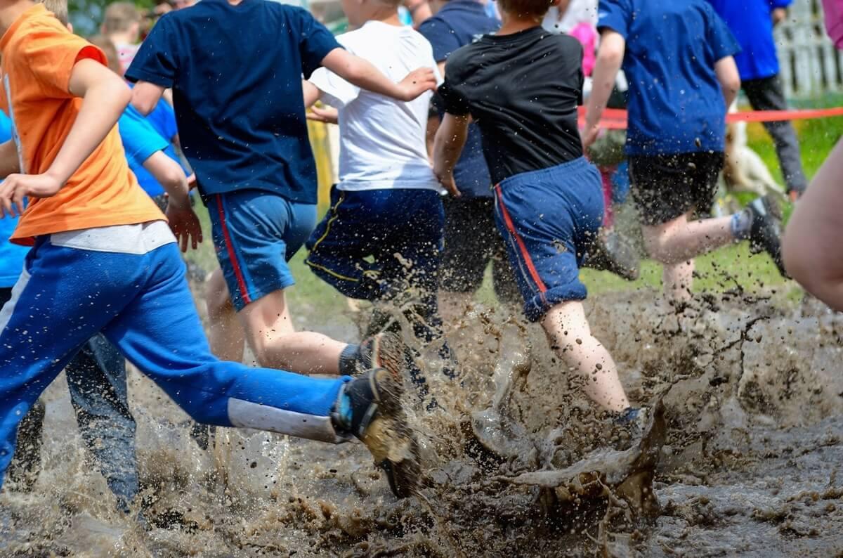 people in a mud run, muddy milar family adventure