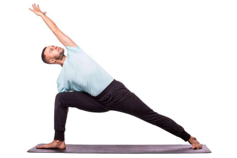 man in yoga stance nurturing health & wellbeing