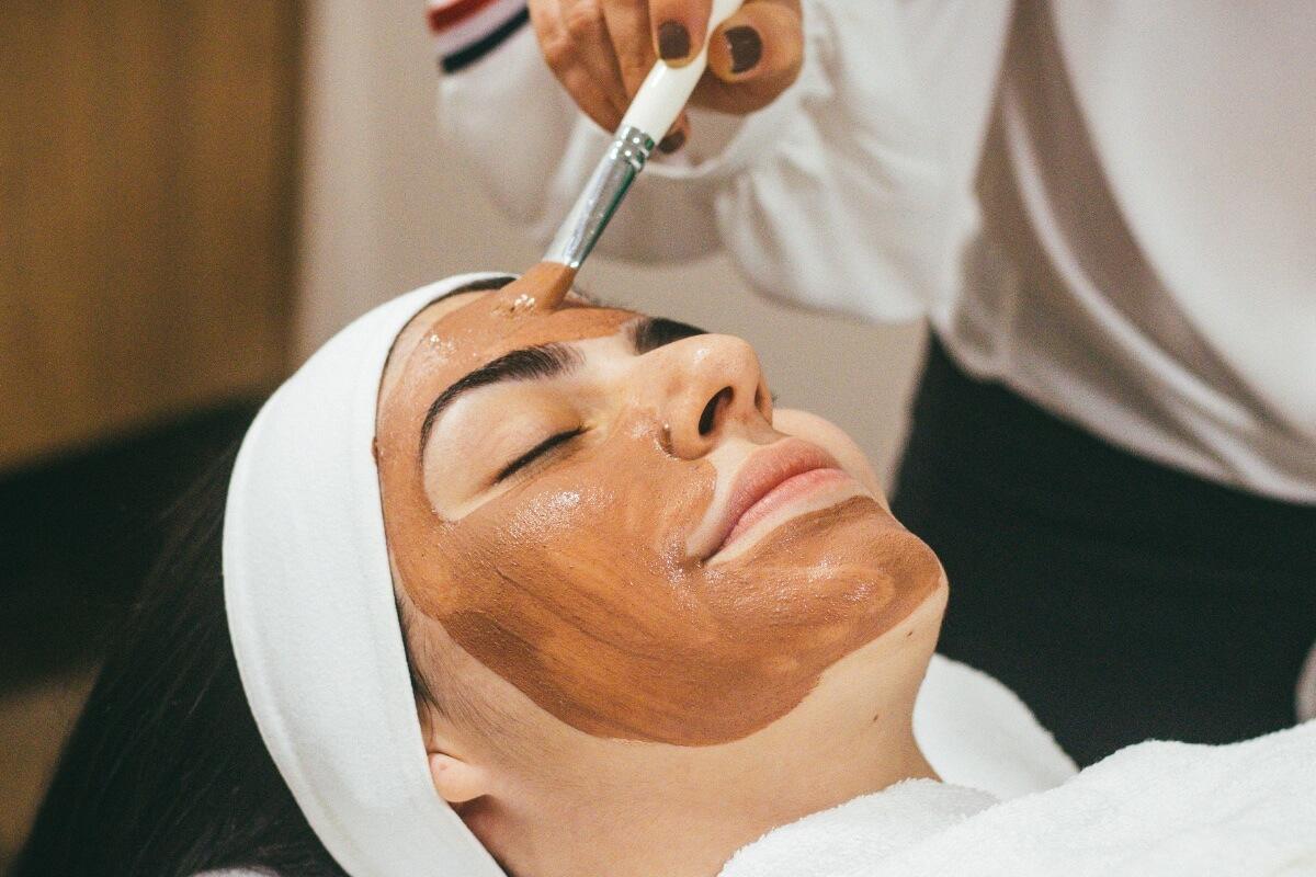 woman getting a facial, a pre-wedding beauty & wellness routine