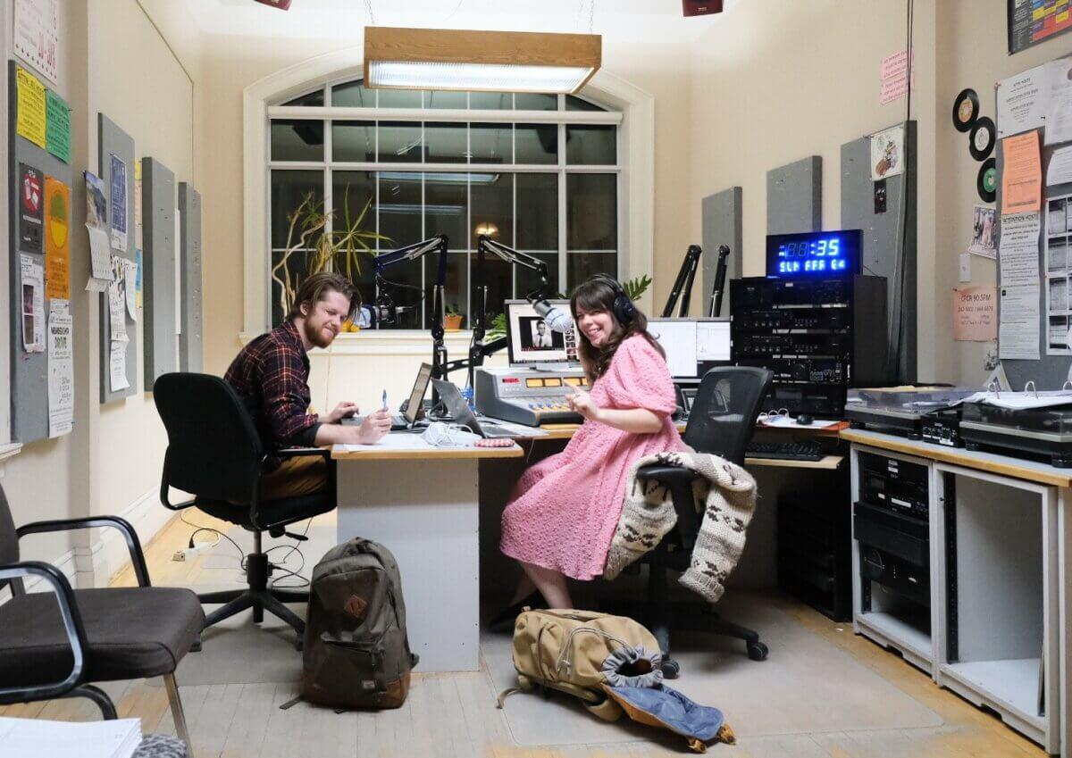 Man and woman recording a show inside Saskatoon community radio station