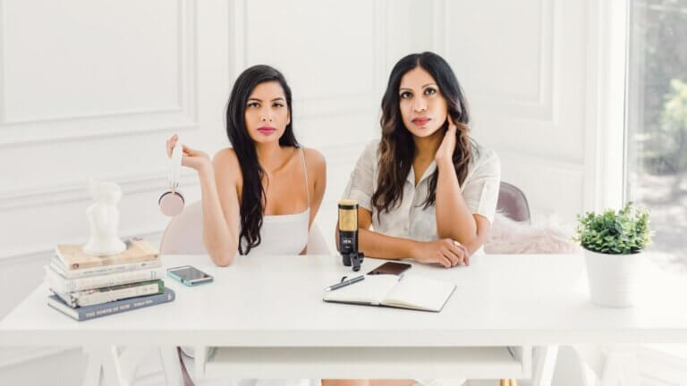 2 women at white table, spreading the mindful word