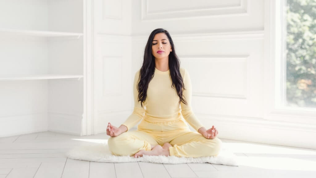 seated woman meditating, and spreading the mindful word