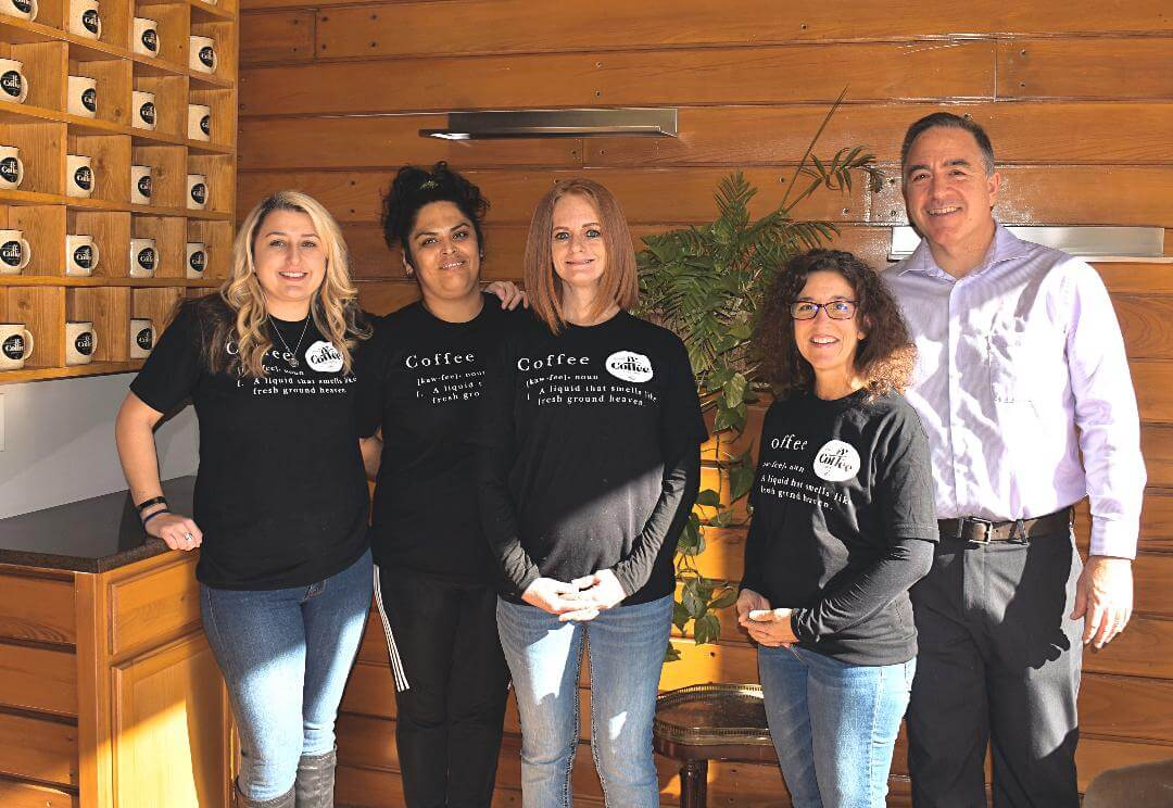 5 staff members at well grounded coffee community