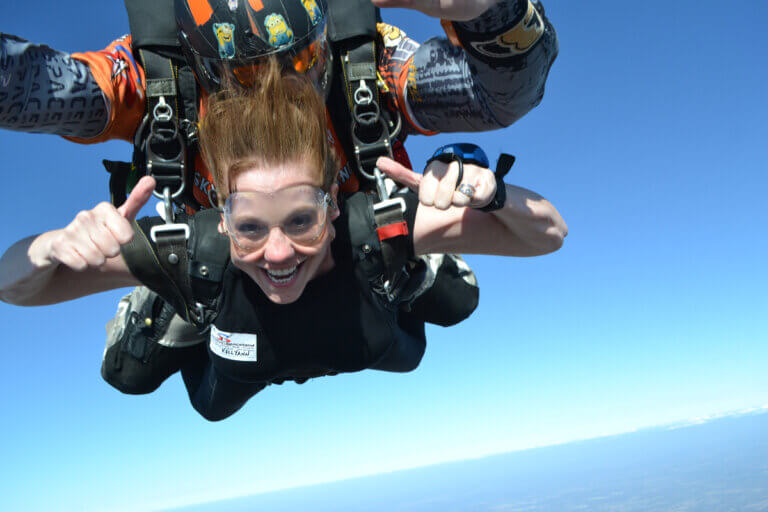 woman skydiving with 2 miles of smiles dallas