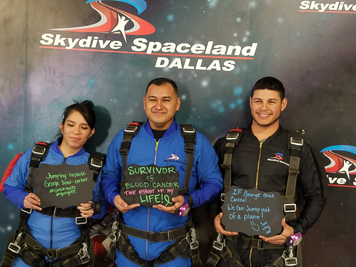 2 men and 1 woman skydiving at 2 miles for smiles