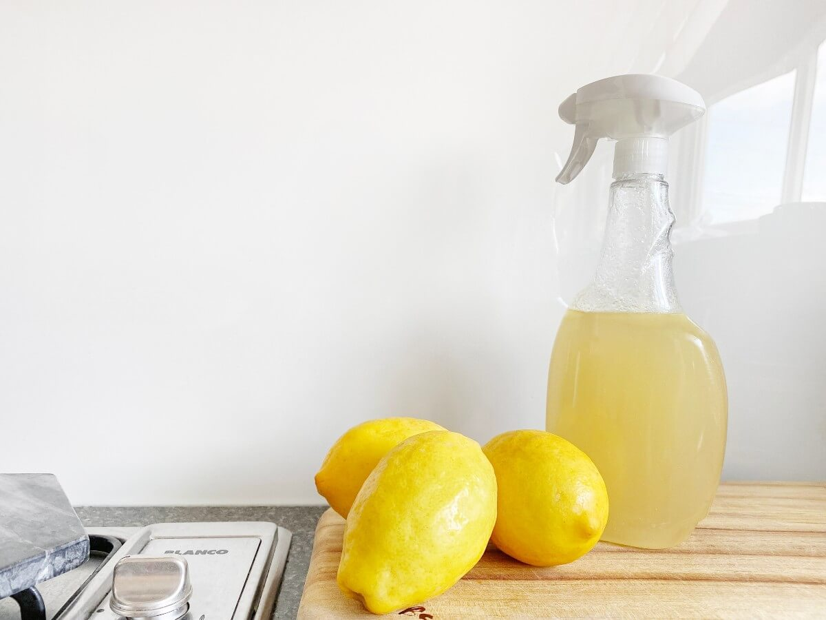 3 lemons and a sprayers on a countertop for spring cleaning, 1 of 5 natural mood boosters