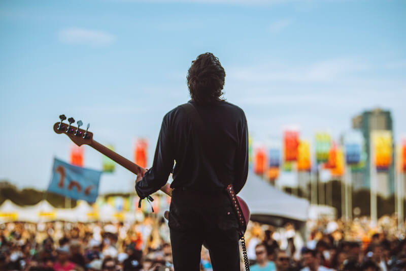 man playing guitar on stage at Austin City Limits Festival