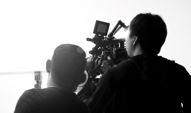 2 men fliming the Building Momentum documentary