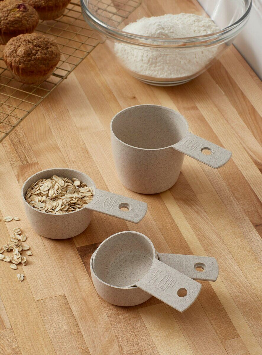 wheat husk measuring cups with bowl of flour and muffins