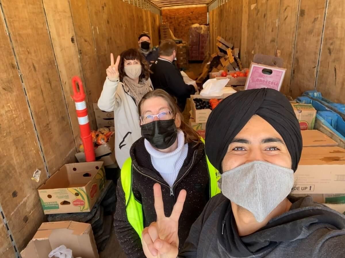 Volunteers organizing food for Guru Nanak Free Kitchen meals on Sundays