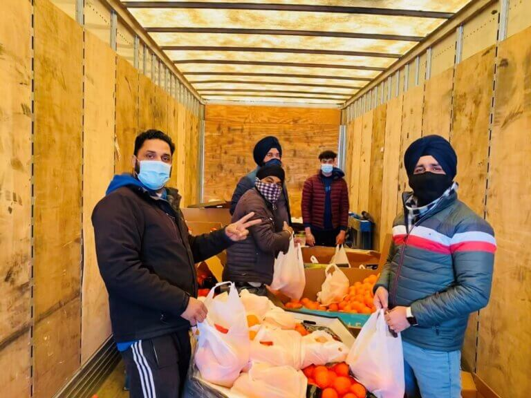 men preparing food for guru nanuk food kitchen