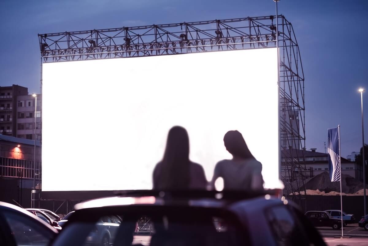 2 girls at a drive in bon jovi concert