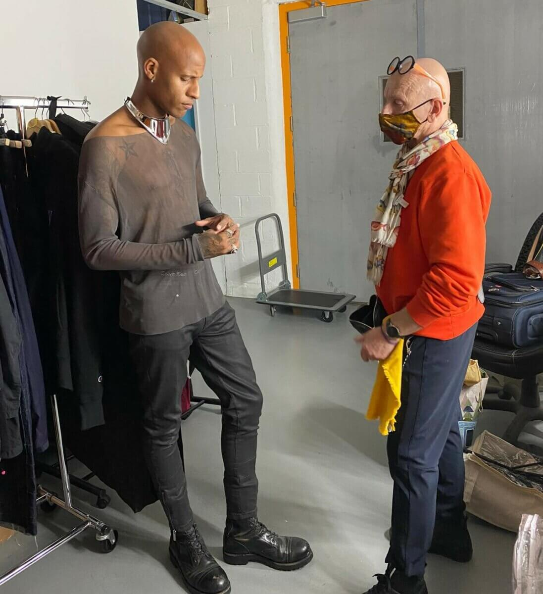 black man and a white man in a styling area behind the scenes, just john and jp michaels