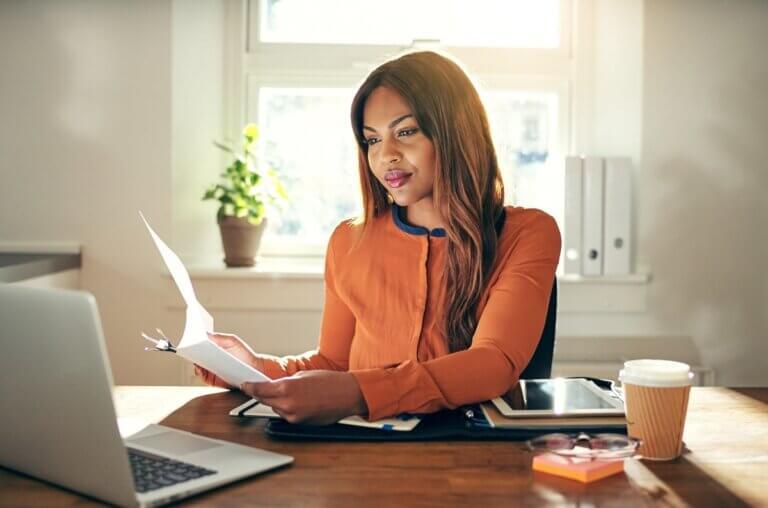 woman at desk mastering entrepreneurship