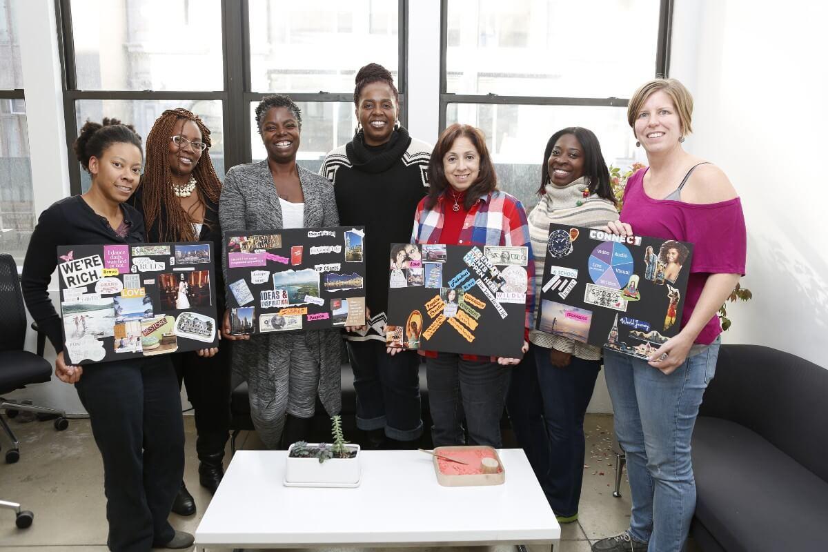 group of women holding meshell baker affirmation cards