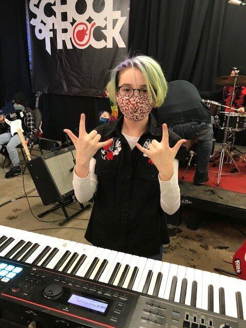 a music student rocking at a keyboard at Regina's School of Rock