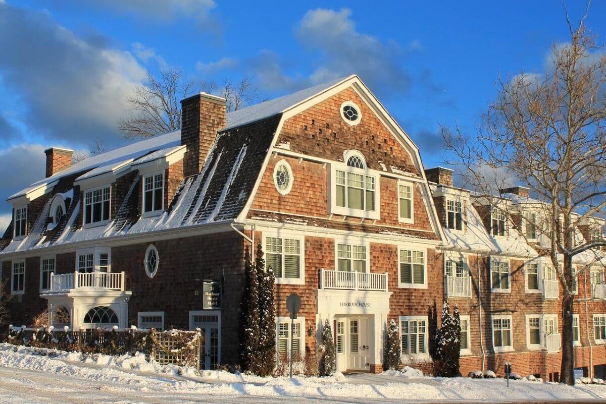 3 story brick building in the winter, Harbour House Hotel is one of Ontario's best weekend getaways